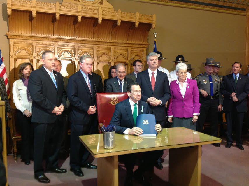 Governor Malloy signs landmark gun violence bill on 2/4/2013